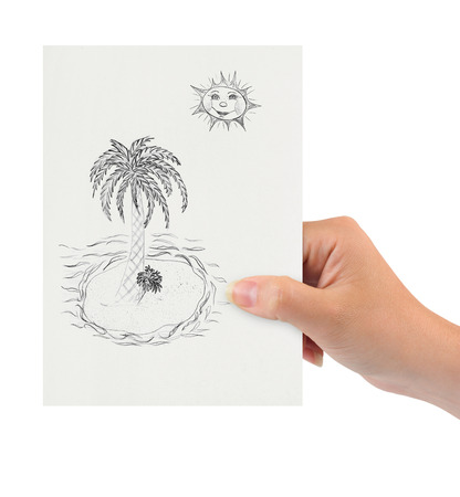 Hand with drawing tropical island isolated on white background photo