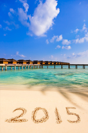 Numbers 2015 on beach - concept holiday background photo