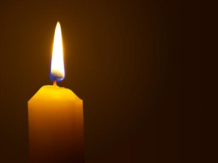 Macro of burning candle isolated on black background photo
