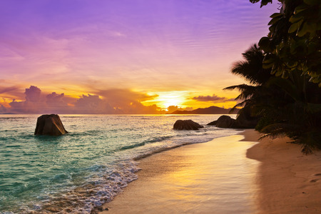 Sunset on tropical beach Source DArgent at Seychelles - nature background photo