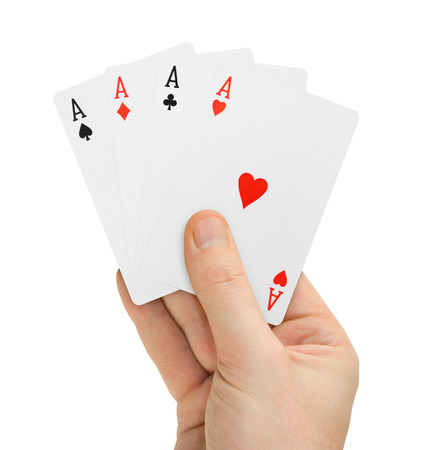 Hand with poker cards isolated on white background photo
