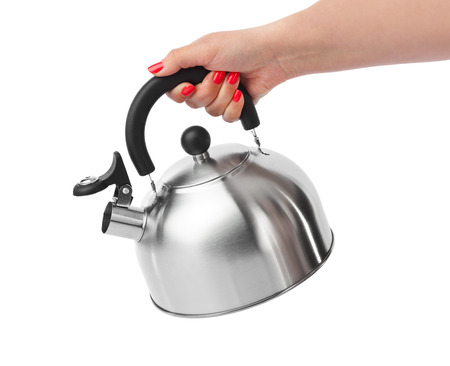 pour water: Stovetop whistling kettle in hand isolated on white background