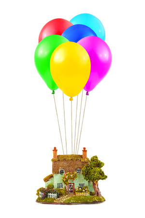 Air balloons and house isolated on white background photo