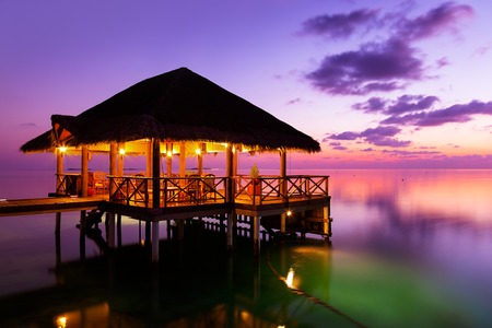 exotic: Water cafe at sunset - Maldives vacation background