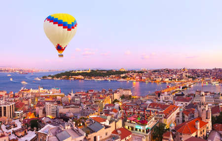Hot air balloon over Istanbul sunset - Turkey travel background Stock Photo
