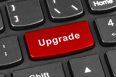 modernize: Computer notebook keyboard with Upgrade key - technology background Stock Photo