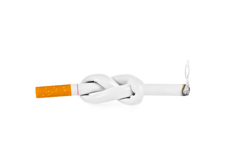 Cigarette with knot isolated on white background photo