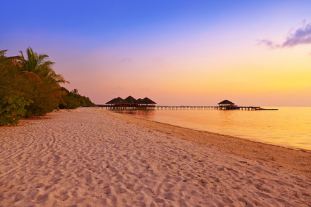 maldives island: Water cafe at sunset - Maldives vacation background