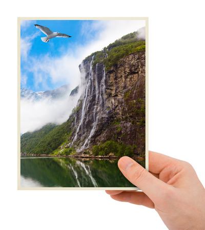 Norway travel photography in hand (my photo) isolated on white background photo