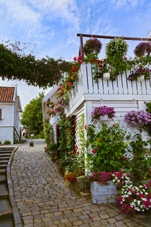 wooden houses: Street with white wooden houses in old centre of Stavanger - Norway - architecture background