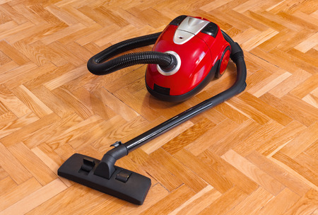 dry cleaner: Vacuum cleaner on parquet - technology housework