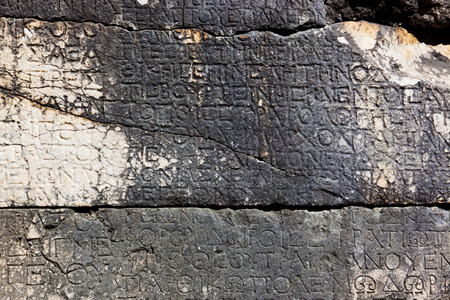 greek alphabet: Old letters on the stone in Phaselis, Turkey