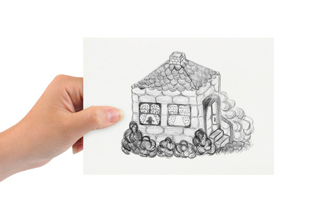 estate planning: Hand with drawing house isolated on white background