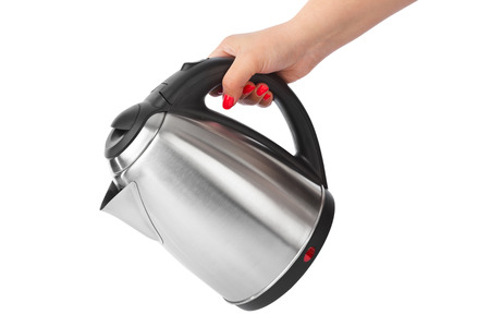 boiling: Electric kettle in hand isolated on white background
