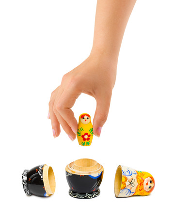 matrioska: Hand and russian toy matrioska isolated on white background Stock Photo
