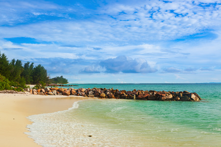 anse: Seychelles tropical beach at sunset - nature background