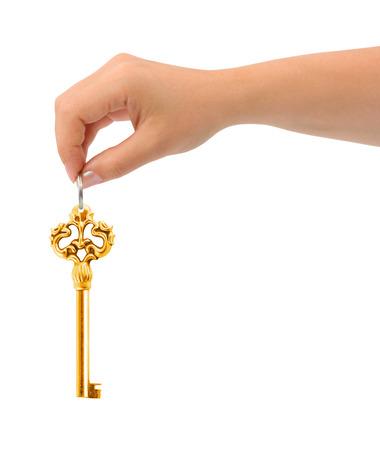 Hand giving key isolated on white background photo