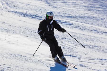 Skier at mountains ski resort Bad Gastein Austria - nature and sport background photo