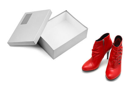 Red shoes and open box isolated on white background photo