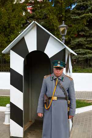 sentry: KOLOMNA, RUSSIA - MAY 03, 2014: Guard in the form of the 19th century policeman in the Kolomna Kremlin - Russia - Moscow region.