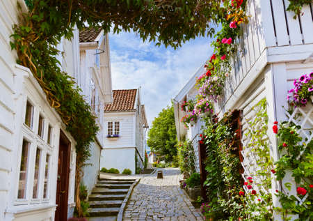norway: Street with white wooden houses in old centre of Stavanger - Norway - architecture background