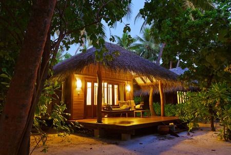 architecture bungalow: Beach bungalow at sunset - Maldives vacation background Editorial