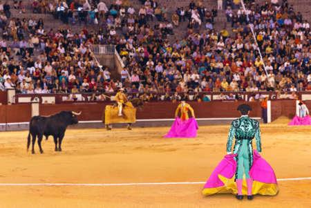 capote: Matador and bull in corrida at Madrid Spain Stock Photo