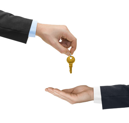 hands holding house: Hands and golden key isolated on white background