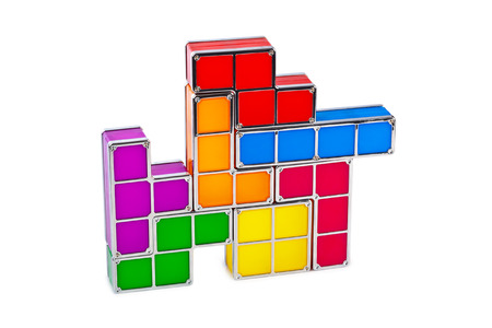 abstract building: Tetris toy blocks isolated on white background Stock Photo