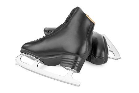 patinaje sobre hielo: Figura patines negros aislados en el fondo blanco