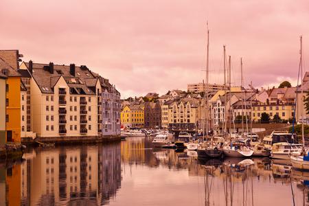 alesund: Cityscape of Alesund Norway at sunset - architecture background