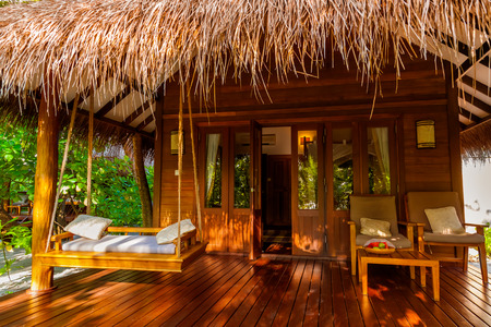 bungalow: Beach bungalow - Maldives vacation background Editorial