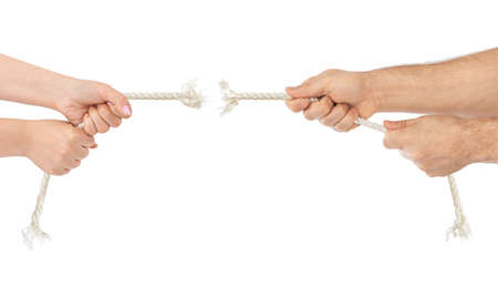Man and woman hands with breaking rope isolated on white background