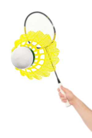 badminton racket: Hand with badminton racket and shuttlecock isolated on white background Stock Photo