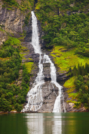 scandinavian landscape: Waterfall in Geiranger fjord Norway - nature and travel background