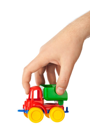 truckload: Toy car truck in hand isolated on white  Stock Photo