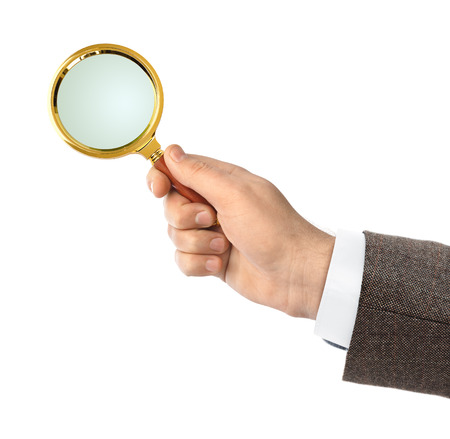 reading glass: Magnifying glass in hand isolated on white background