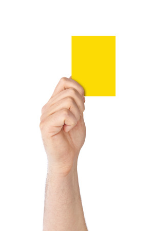 admonition: Hand holding a yellow card isolated on white background