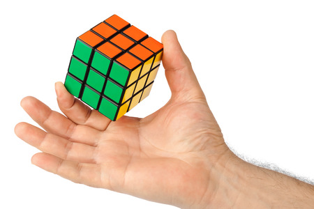 cube puzzle: Cube puzzle in hand isolated on white background