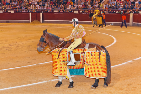 capote: MADRID, SPAIN - SEPTEMBER 18: Matador in bullfight on September 18, 2011 in Madrid, Spain. Editorial