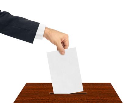 ballot papers: Hand with paper ballot isolated on white background Stock Photo