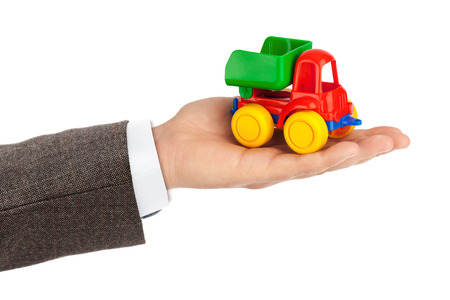 truckload: Toy car truck in hand isolated on white background Stock Photo