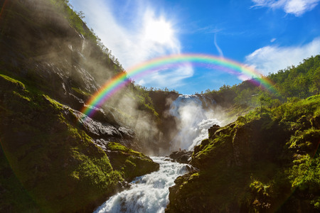 waterfall with sky: Giant Kjosfossen waterfall in Flam - Norway - nature and travel background