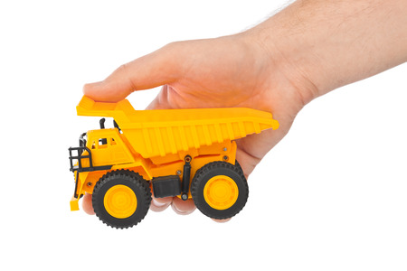 hand truck: Toy car truck in hand isolated on white background Stock Photo