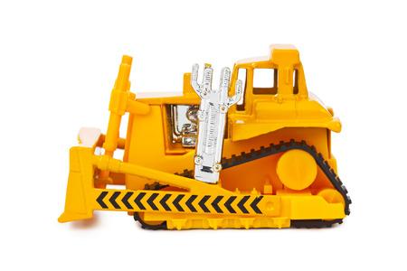heavy equipment operator: Toy bulldozer isolated on white background
