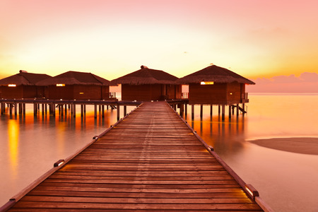 bungalows: Water bungalows on Maldives island - nature travel background