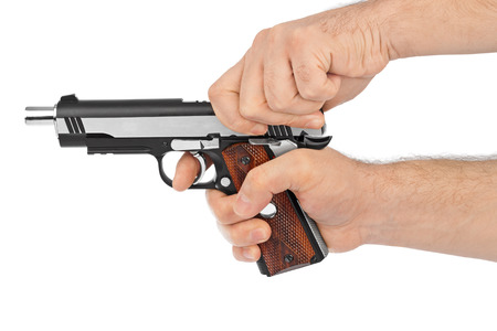 man with gun: Hand with pistol isolated on white background