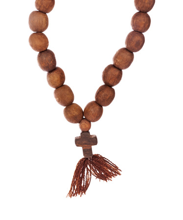 the believer: Wooden rosary isolated on white background Stock Photo