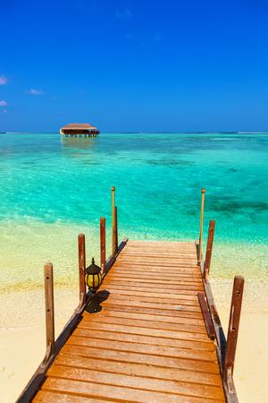 bungalow: Water bungalow on Maldives island - nature travel background