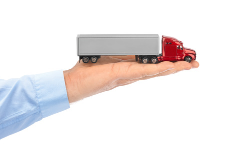 toy truck: Toy car truck in hand isolated on white background Stock Photo